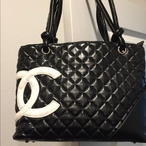 Black quilted handbag with matching wallet